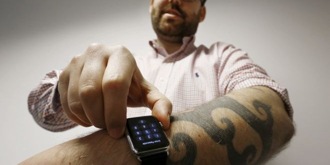 Reuters journalist Matt Siegel inputs his passcode onto his Apple Watch as his tattoos prevent the device's sensors from correctly detecting his skin, in Sydney