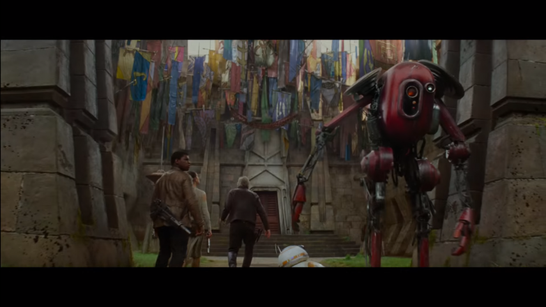 Now here is where it gets interesting: Han Solo, Finn, and Rey entering a building associated with the Mandalorians